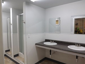 Women's side of unit with double vanity.