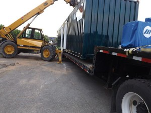Unit being loaded onto the flatbed truck that will be taking it to its new home.